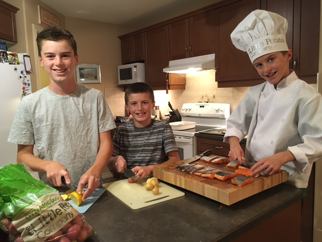The Little Potato Company's Little Chef Owen cooks at home with his brothers.
